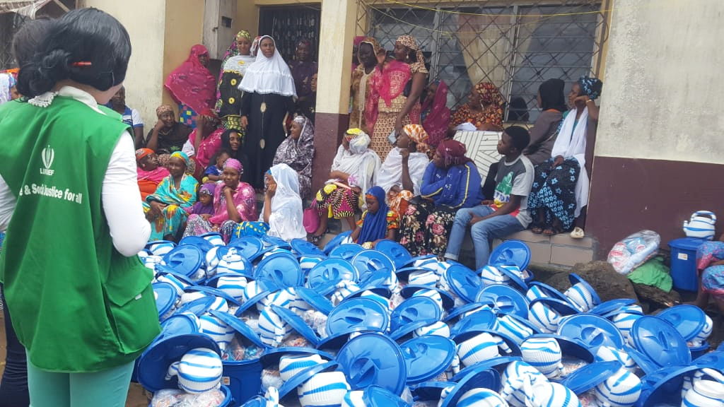 Group of people receiving dignity kits